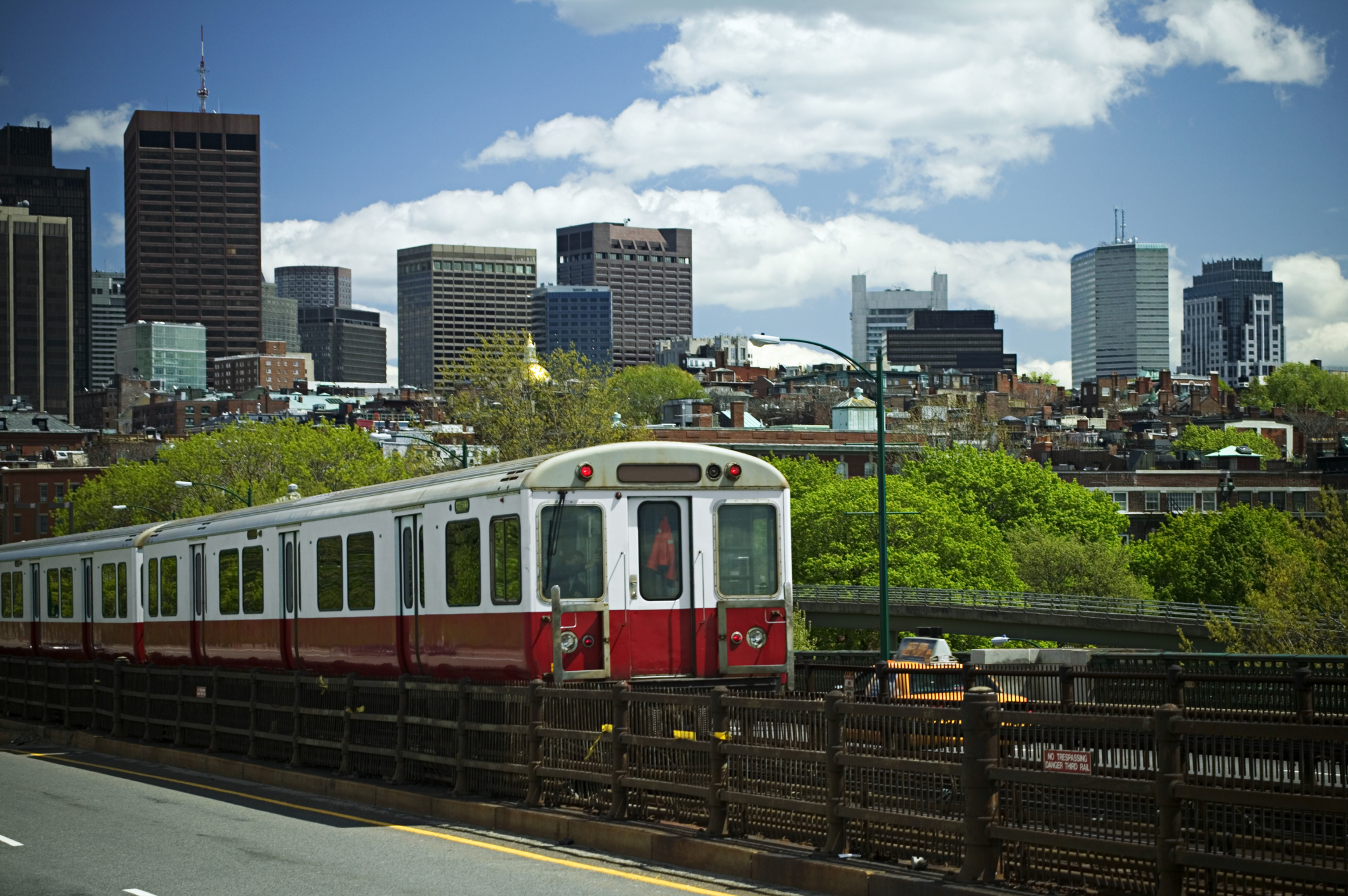 Red line train with Boston skyline